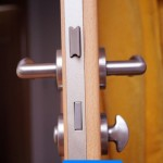 wooden door with silver doorhandle at home